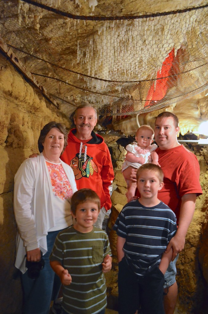 family photo in Crystal Lake Cave Dubuque, Iowa