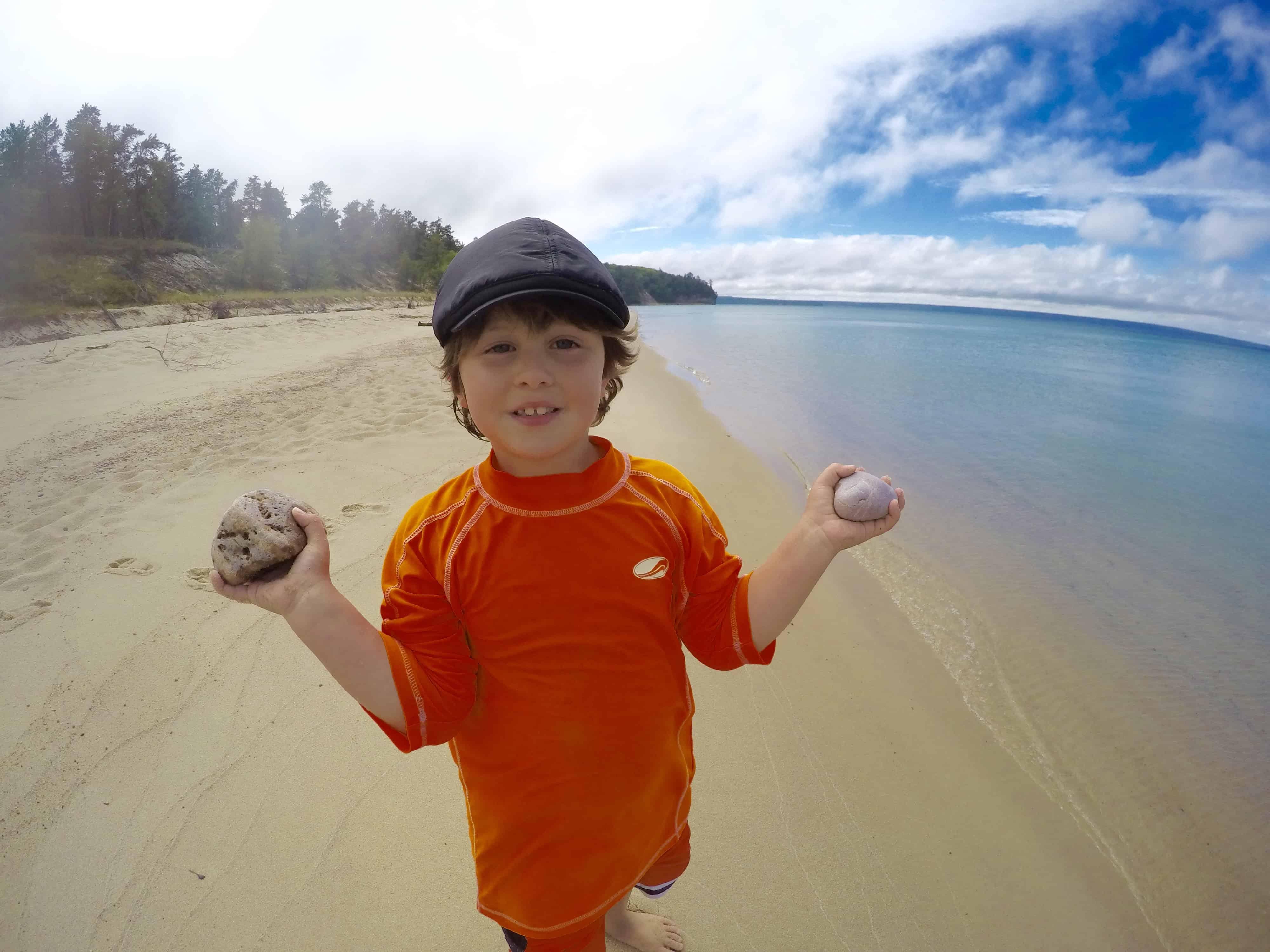 boy holding rocks at Pictured Rocks National Lakeshore