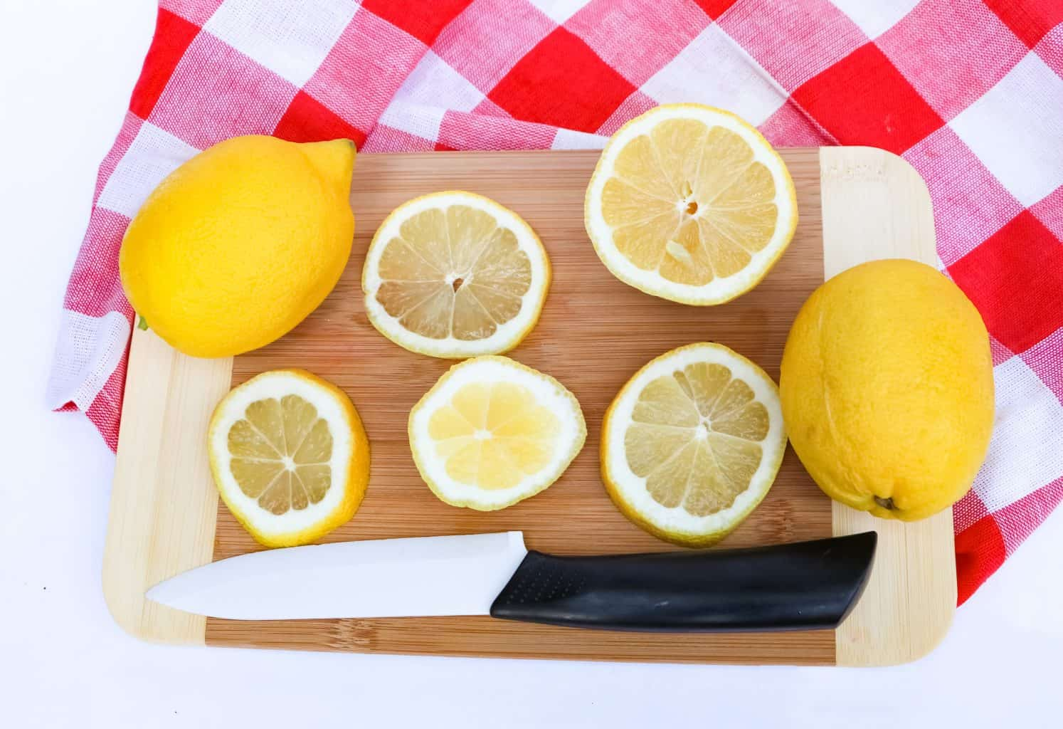 cutting slices of lemons for spiked tea recipe