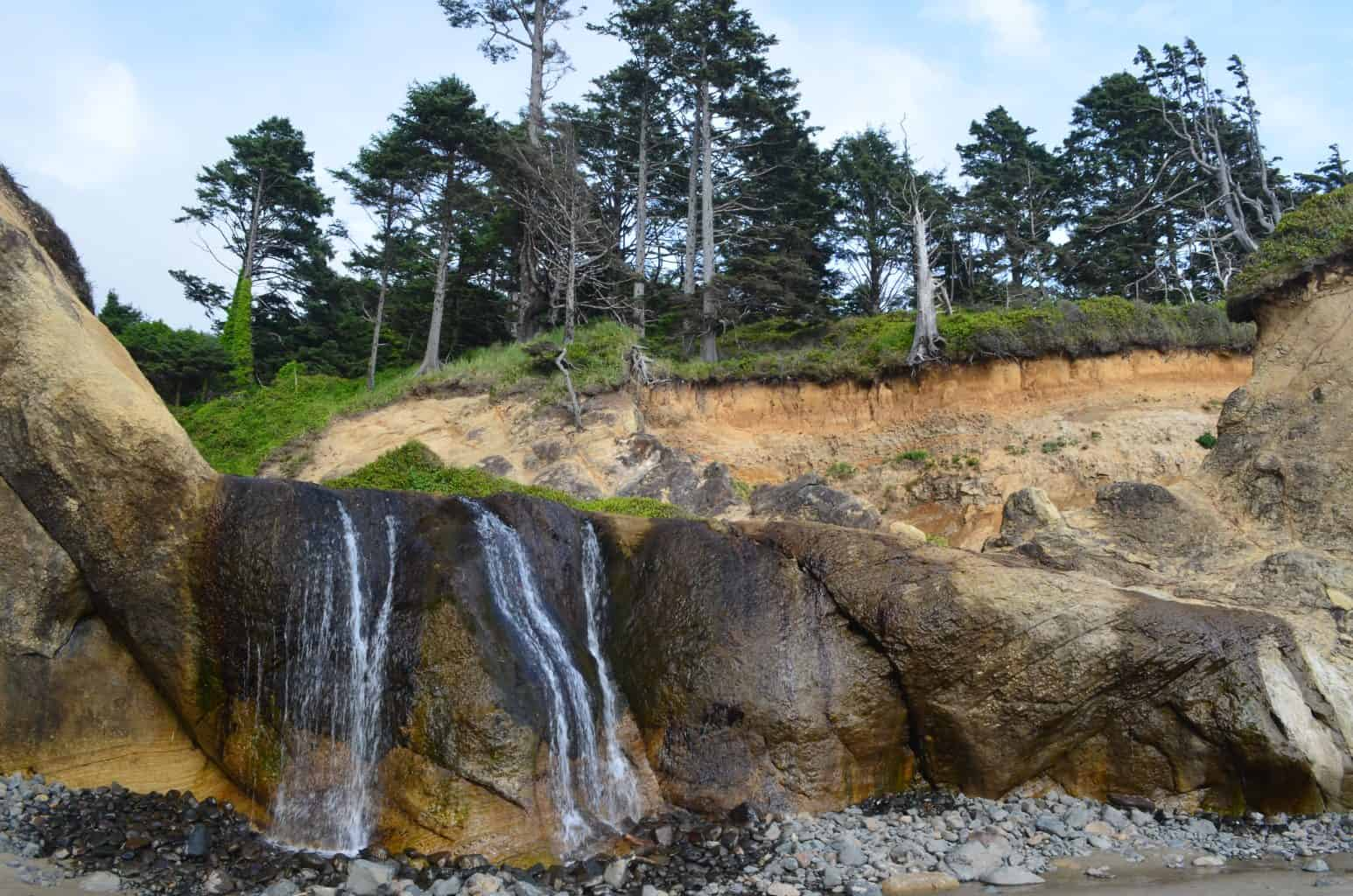 waterfall Hug Pointe State Park Oregon beach