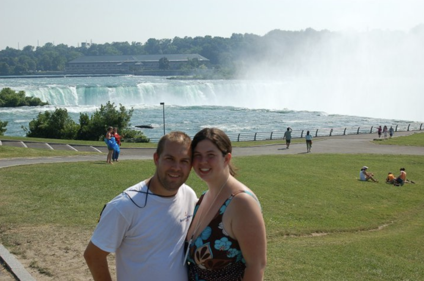 couple standing in front of Horseshoe Falls USA