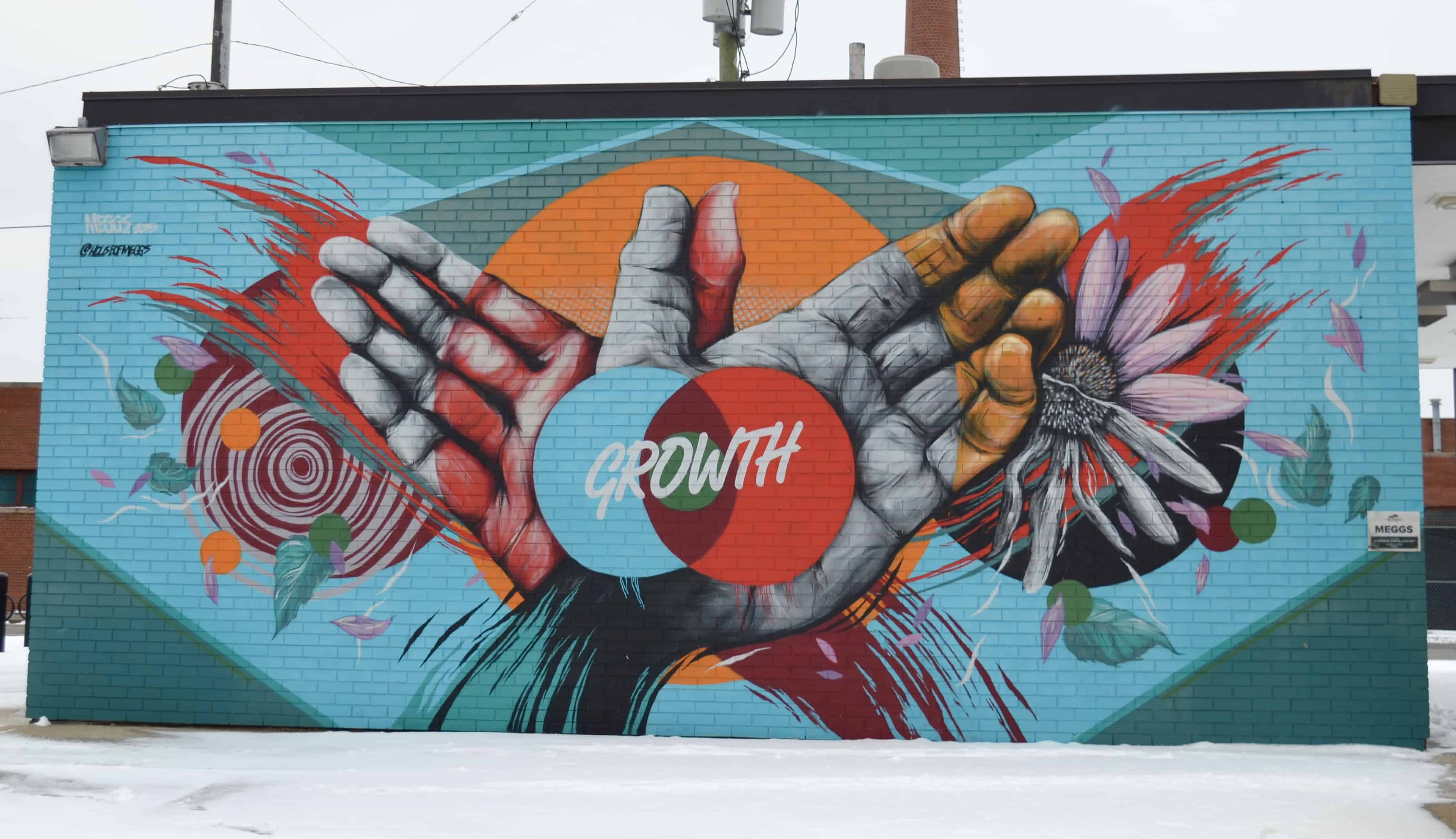growth hands art mural detroit