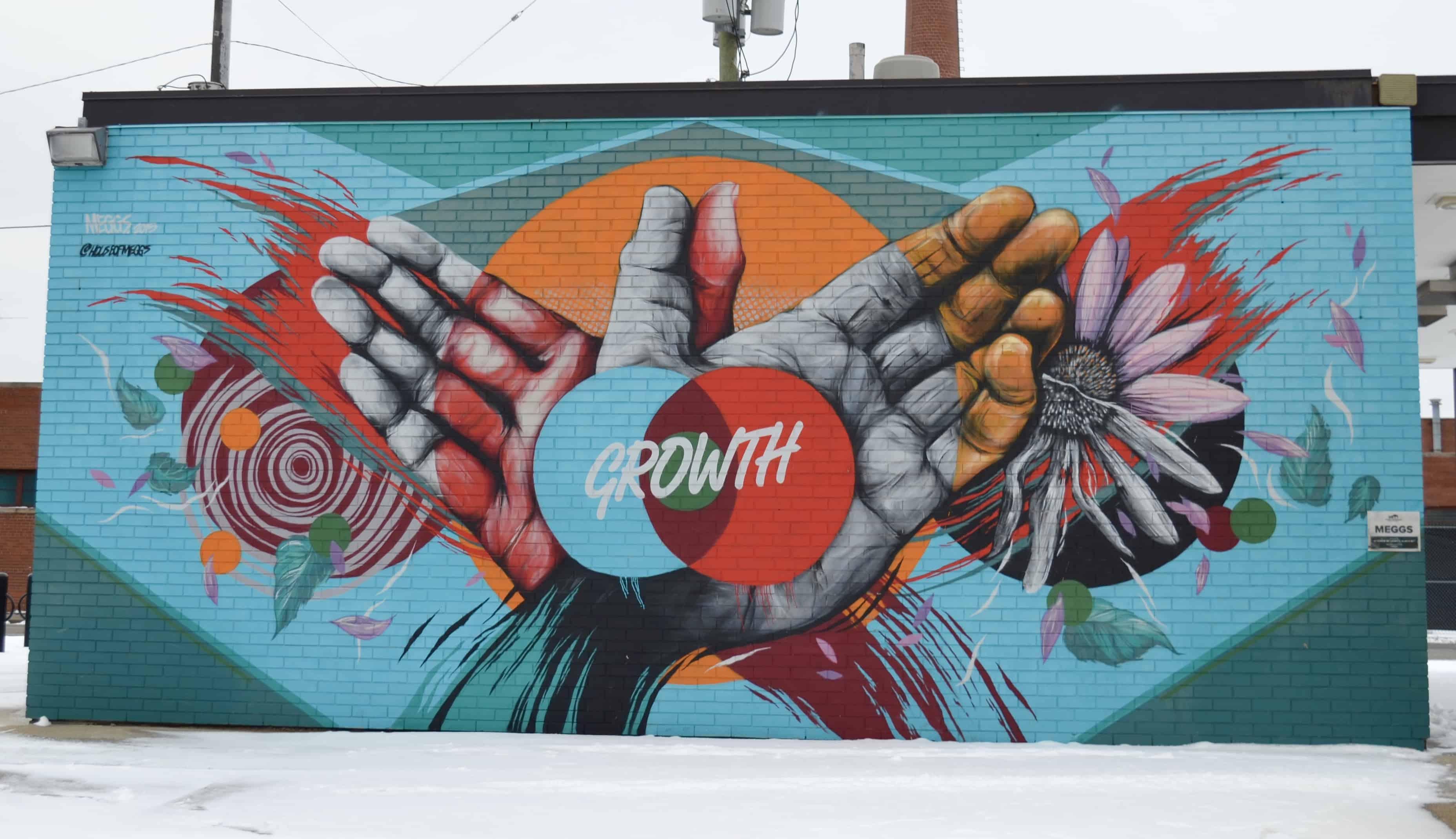 growth hands art mural detroit
