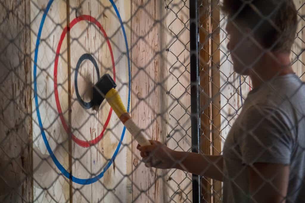 axe in bullseye on wood wall