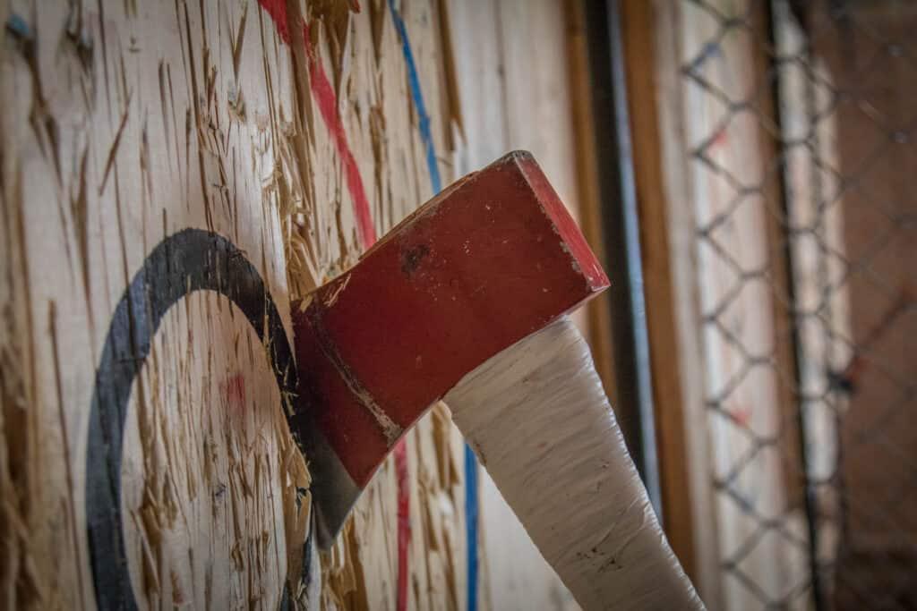 red axe in bullseye on wood wall