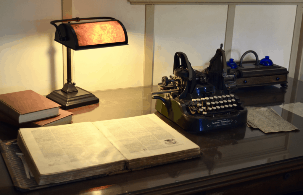 antique typewriter lamp and desk