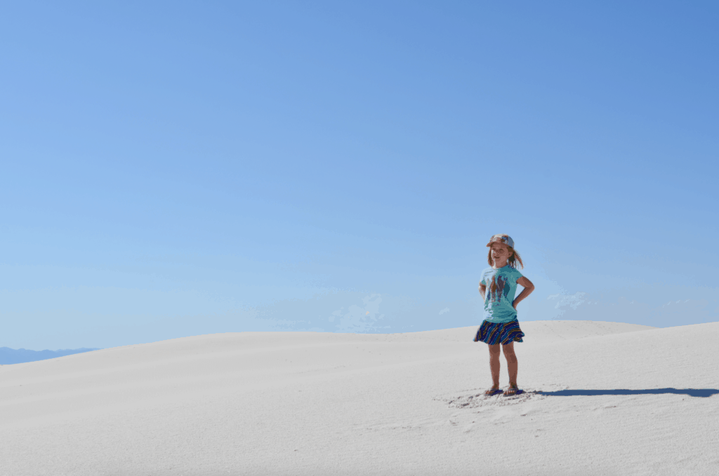 girl standing in white sand