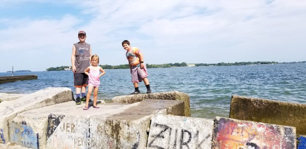 kids on rocks in front of Lake Erie