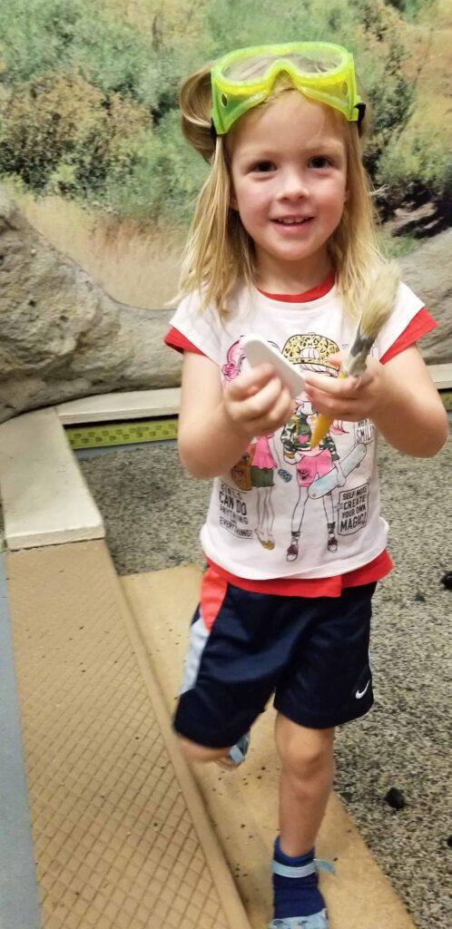 girl digging for dinosaurs