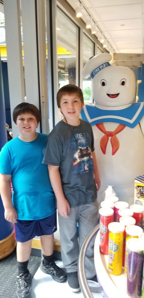 boys next to Stay Puft Ghostbusters