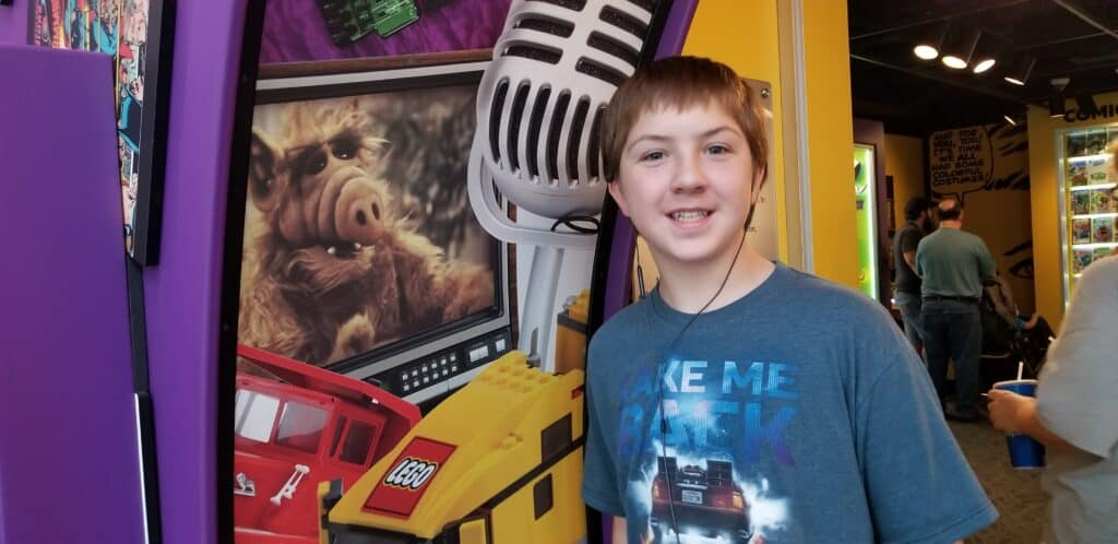 teen boy next to Alf picture