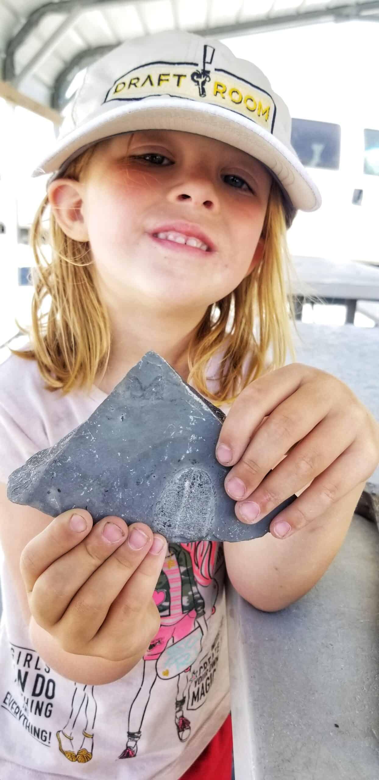 girl digging for fossils in Utah