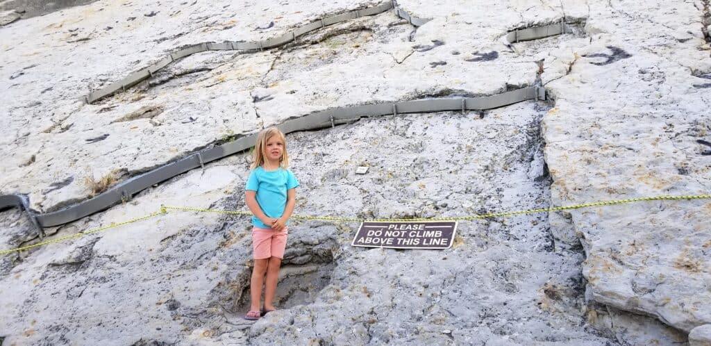 little girl at dinosaur tracks footprint fossils