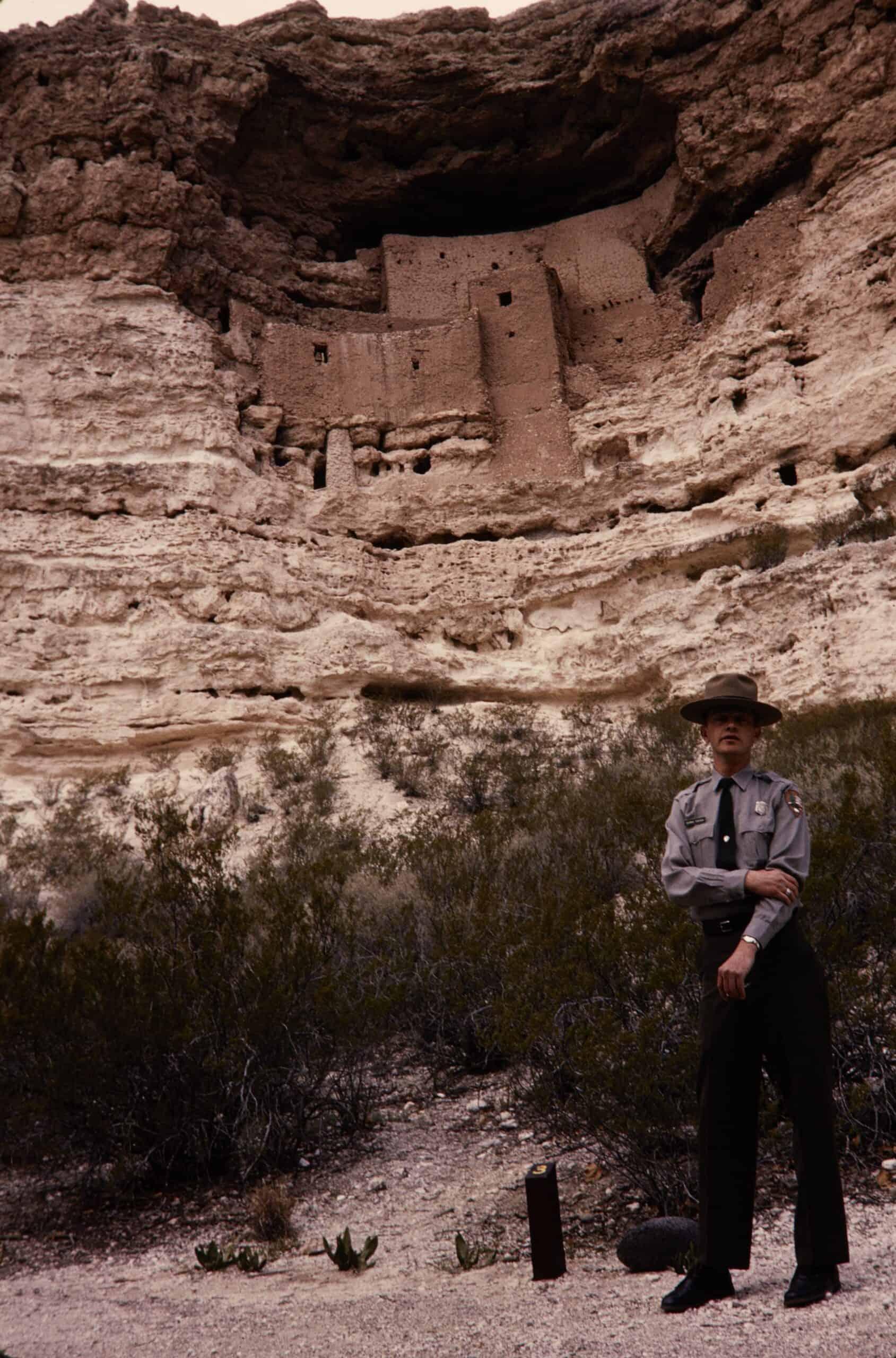 national park ranger in front of Montezuma National Monument
