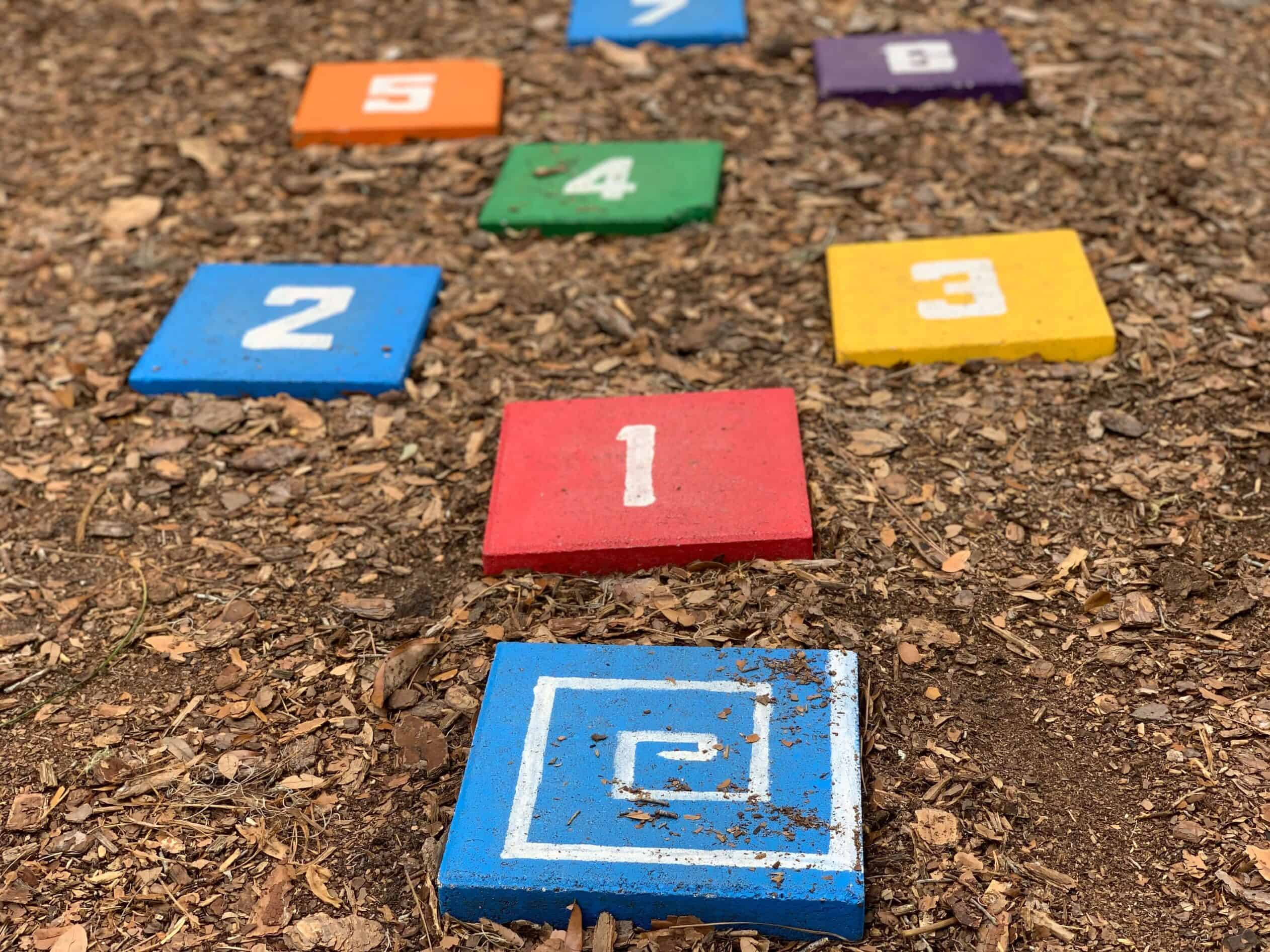 colored bricks with numbers for hopscotch